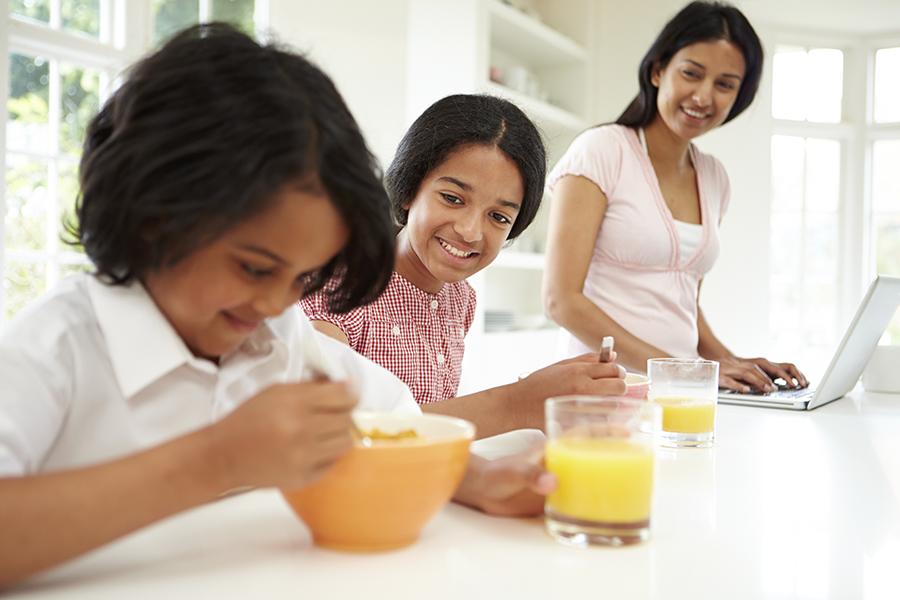 Children having breakfast with mum