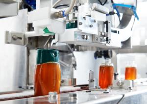 ligne de dosage, remplissage, bouchonnage pour une ligne de production de miel